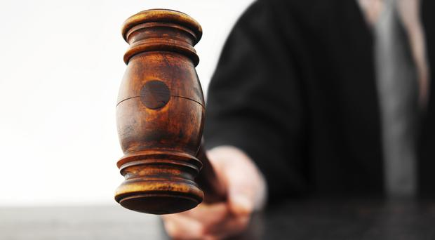 The District Judge said two police witnesses had written in statements that they saw the defendant and another man shaking collection jars and collecting money from passing motorists (stock photo)