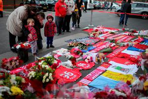 LIVERPOOL, ENGLAND - APRIL 26:  A man reacts as people lay flowers and tributes at the Hillsborough Memorial outside Anfield Stadium, the home of Liverpool Football Club on April 26, 2016 in Liverpool, England. The fresh inquests into the 1989 Hillsborough disaster, in which 96 football supporters were crushed to death, concluded today on April 26, 2016 with a verdict of unlawful killing, after the initial verdicts were quashed. Relatives of Liverpool supporters who died in Britain's worst sporting disaster gathered in the purpose-built court to hear the jury's verdict in Warrington after a 25 year fight to overturn the accidental death verdicts handed down at the initial 1991 inquiry.  (Photo by Christopher Furlong/Getty Images)