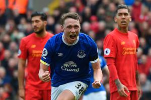 Everton's English defender Matthew Pennington celebrates after scoring their first goal during the English Premier League football match between Liverpool and Everton at Anfield in Liverpool, north west England on April 1, 2017. / AFP PHOTO / PAUL ELLIS / RESTRICTED TO EDITORIAL USE. No use with unauthorized audio, video, data, fixture lists, club/league logos or 'live' services. Online in-match use limited to 75 images, no video emulation. No use in betting, games or single club/league/player publications.  / PAUL ELLIS/AFP/Getty Images