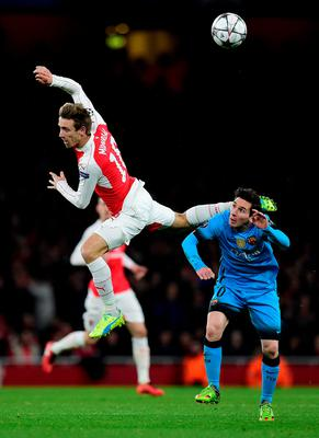 Arsenal's Spanish defender Nacho Monreal (L) clashes with Barcelona's Argentinian forward Lionel Messi during the UEFA Champions League round of 16 1st leg football match between Arsenal and Barcelona at the Emirates Stadium in London on February 23, 2016.   / AFP / JAVIER SORIANOJAVIER SORIANO/AFP/Getty Images