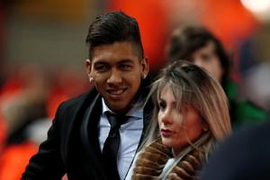"Liverpool's Roberto Firmino (left) arrives with partner ahead of the Emirates FA Cup, third round replay at Anfield, Liverpool. PRESS ASSOCIATION Photo. Picture date: Wednesday January 20, 2016. See PA story SOCCER Liverpool. Photo credit should read: Peter Byrne/PA Wire. RESTRICTIONS: EDITORIAL USE ONLY No use with unauthorised audio, video, data, fixture lists, club/league logos or ""live"" services. Online in-match use limited to 75 images, no video emulation. No use in betting, games or single club/league/player publications."