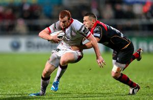 Ulster's Peter Nelson is tackled by the Dragons Jason Tovey. Darren Kidd / Press Eye.