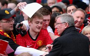 MANCHESTER, ENGLAND - MAY 12:  Manchester United Manager Sir Alex Ferguson signs autographs prior to the Barclays Premier League match between Manchester United and Swansea City at Old Trafford on May 12, 2013 in Manchester, England.  (Photo by Alex Livesey/Getty Images)