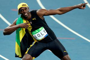Usain Bolt of Jamaica celebrates winning the Men's 100 meter final on Day 9 of the Rio 2016 Olympic Games at the Olympic Stadium on August 14, 2016 in Rio de Janeiro, Brazil.  (Photo by Ezra Shaw/Getty Images)