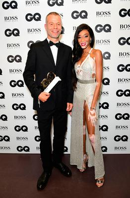 Wolfgang Tillmans with his Maddox Gallery Artist award poses with Winnie Harlow during the GQ Men of the Year Awards 2017 held at the Tate Modern, London. PRESS ASSOCIATION Photo. Picture date: Tueday September 5th, 2017. Photo credit should read: Ian West/PA Wire