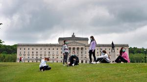 A group of friends from different households wear face masks as they meet again for the first time together since the Covid-19 lockdown began at Stormont on May 19, 2020. (Photo by Charles McQuillan/Getty Images)