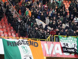 @Press Eye Ltd Northern Ireland- 11th March  2013 Mandatory Credit - Brian Little/ Presseye  Setanta Sports Cup- Linfield FC v Shamrock Rovers  PSNI control Shamrock Rovers fans after troulbe flares  at  Linfield   and Shamrock Rovers   during Monday night's Setanta Sports Cup quarter final second leg match at Windsor Park.
