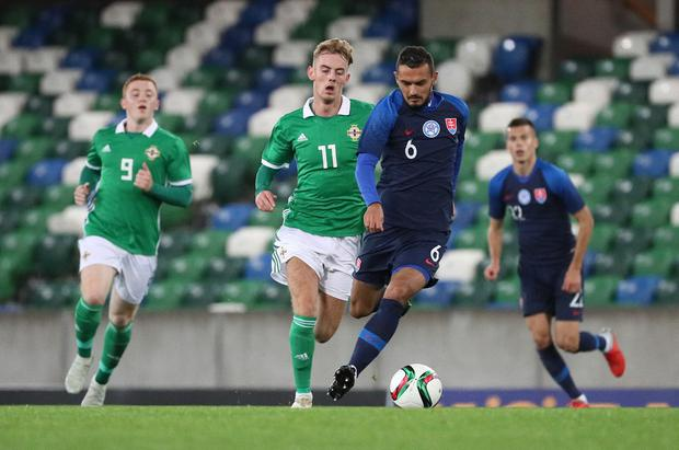 Pacemaker Belfast 16-10-18 Northern Ireland v Slovakia - UEFA Euro U21 Qualifier Northern Ireland's Mark Sykes and Slovakia's Martin Sulek during this evenings game at the National Stadium, Belfast.  Photo by David Maginnis/Pacemaker Press