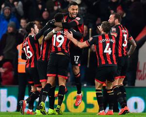 So easy: Joshua King (c) after scoring Bournemouth's third goal