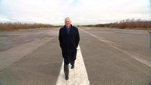Harry Gregg outside the old terminal building. (runway)