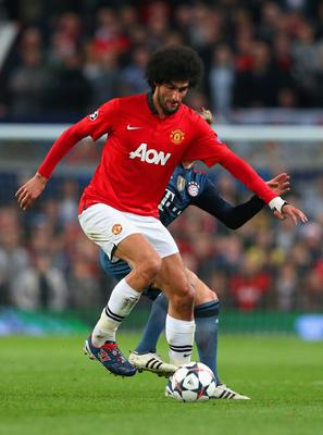 MANCHESTER, ENGLAND - APRIL 01:  Marouane Fellaini of Manchester United on the ball during the UEFA Champions League Quarter Final first leg match between Manchester United and FC Bayern Muenchen at Old Trafford on April 1, 2014 in Manchester, England.  (Photo by Alex Livesey/Getty Images)