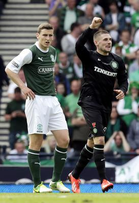 Celtic's Gary Hooper celebrates his second goal as Hibernian's Paul Hanlon (left) stands dejected during the William Hill Scottish Cup Final at Hampden Park, Glasgow. PRESS ASSOCIATION Photo. Picture date: Sunday May 26, 2013. See PA story SOCCER Scottish Cup. Photo credit should read: Danny Lawson/PA Wire. EDITORIAL USE ONLY.