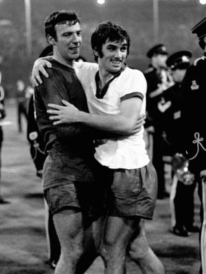 File photo dated 29-05-1968 of Manchester United's David Sadler (left) and George Best celebrate winning the European Cup. PRESS ASSOCIATION Photo. Issue date: Monday February 5, 2018. The images are etched in the memory. George Best dribbling the ball around the goalkeeper and sliding the ball into the net. See PA story SOCCER Munich European Cup. Photo credit should read PA Photos/PA Wire.