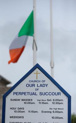 A flag flies at half mast at Our Lady of Perpetual Succour church in Foxrock, Dublin, to honour the victims of the Berkeley balcony collapse. PRESS ASSOCIATION Photo. Picture date: Thursday June 18, 2015. The victims - five from Ireland and one from California - plunged to their deaths while celebrating a 21st birthday party in the US city. See PA story IRISH Balcony. Photo credit should read: Niall Carson/PA Wire