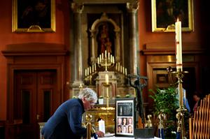 Members of the public sign a book of condolence at the Pro-Cathedral in Dublin's city centre for those killed in the Berkeley balcony collapse. PRESS ASSOCIATION Photo. Picture date: Saturday June 20, 2015. Photo credit should read: Brian Lawless/PA Wire