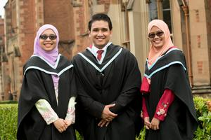 Siti Binto Che Elias (L), Afdhal Anuar and Aida Adila Yuhaznel (R) from Malaysia are celebrating having graduated with a Masters in Chemical Engineering from Queen's University Belfast