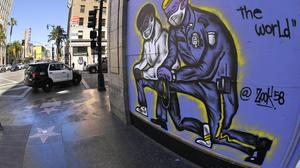 The US police reality show Cops has been dropped amid tensions over treatment of black people by law enforcement agencies (Mark J Terrill/AP)