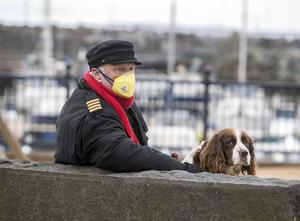 Ballycastle sea captain Christopher McCaughan walks his dog Biscuit  close to his home in Ballycastle, Co Antrim on Thursday March 26th. Steven McAuley/McAuley Multimedia