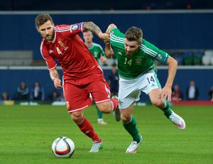 BELFAST, NORTHERN IRELAND - SEPTEMBER 7:  Stuart Dallas (R) of Northern Ireland and Tamas Kadar (L) of Hungary during the Euro 2016 Group F qualifying match at Windsor Park on September 7, 2015 in Belfast, Northern Ireland.  (Photo by Charles McQuillan/Getty Images)