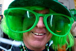 A parade participant poses on 5th Avenue during the 255th New York City St Patrick's Day Parade on March 17, 2016. / AFP PHOTO / Timothy A. CLARYTIMOTHY A. CLARY/AFP/Getty Images