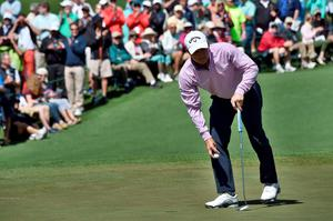 US golfer Kevin Kisner lines up his putt during Round 1 of the 80th Masters Golf Tournament at the Augusta National Golf Club on April 7, 2016, in Augusta, Georgia.   / AFP PHOTO / Nicholas KammNICHOLAS KAMM/AFP/Getty Images