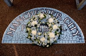 MANCHESTER, ENGLAND - AUGUST 19:  A wreath is laid in memory of Bert Trautmann the former goalkeeper who died in July prior to the Barclays Premier League match between Manchester City and Newcastle United at the Etihad Stadium on August 19, 2013 in Manchester, England.  (Photo by Michael Regan/Getty Images)