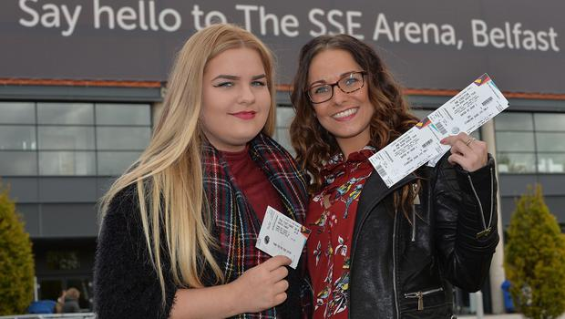 One Direction's current On The Road Again world tour hits Belfast. Harry Styles, Liam Payne, Louis Tomlinson and MullingarÕs own Niall Horan will take to the stage at the SSE Arena in Belfast from Tuesday 20 Ð Thursday 22 October 2015. Fans Emma and Maria Kearney from Newry pictured outside the SSE Arena in Belfast for the first of 3 concerts tonight. Picture By: Pacemaker Press