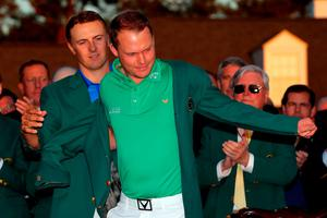AUGUSTA, GEORGIA - APRIL 10:  Jordan Spieth of the United States presents Danny Willett of England with the green jacket after Willett won the final round of the 2016 Masters Tournament at Augusta National Golf Club on April 10, 2016 in Augusta, Georgia.  (Photo by Kevin C. Cox/Getty Images)