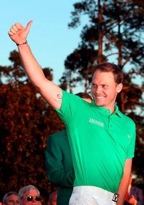 AUGUSTA, GEORGIA - APRIL 10:  Danny Willett of England celebrates winning during the green jacket ceremony after the final round of the 2016 Masters Tournament at Augusta National Golf Club on April 10, 2016 in Augusta, Georgia.  (Photo by Andrew Redington/Getty Images)