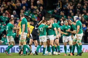 Ireland's players celebrate their win on the pitch after the rugby union test match between Ireland and Australia at the Aviva stadium in Dublin on November 26, 2016. Ireland won the game 27-24. / AFP PHOTO / PAUL FAITHPAUL FAITH/AFP/Getty Images