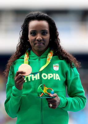 RIO DE JANEIRO, BRAZIL - AUGUST 12:  Tirunesh Dibaba of Ethiopia poses with the bronze medal for the Women's 10,000 Meters Final on Day 7 of the Rio 2016 Olympic Games at the Olympic Stadium on August 12, 2016 in Rio de Janeiro, Brazil.  (Photo by Alexander Hassenstein/Getty Images)