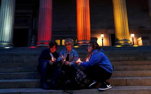 Cat Brady and Robyn Moore sit on the steps of St Georges Hall, Liverpool, as they attend a vigil for the victims of the Orlando Shootings at a Gay nightclub in Florida. Peter Byrne/PA Wire