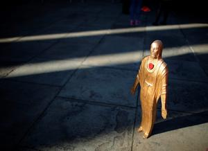 LIVERPOOL, ENGLAND - APRIL 27:  A figurine of Jesus Christ is placed outside Liverpool's Saint George's Hall as thousands of people gather to attend a vigil for the 96 victims of the Hillsborough tragedy on April 27, 2016 in Liverpool, England. The civic commemoration event marks the outcome of the fresh inquests into the 1989 Hillsborough disaster, in which 96 football supporters were crushed to death, and concluded yesterday with a verdict of unlawful killing. Relatives, Liverpool supporters and members of the public are taking part in the vigil at St George's Hall where a candle is lit for each of the 96 victims who lost their lives during a crush at the Hillsborough football ground in Sheffield, South Yorkshire in 1989..  (Photo by Christopher Furlong/Getty Images)