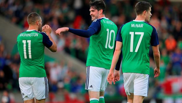 Northern Ireland's Conor Washington (left) celebrates with team-mate Kyle Lafferty (centre) after scoring his side's second goal during the International Friendly at Windsor Park, Belfast. PRESS ASSOCIATION Photo. Picture date: Friday May 27, 2016. See PA story SOCCER N Ireland. Photo credit should read: Niall Carson/PA Wire. RESTRICTIONS: Editorial use only, No commercial use without prior permission, please contact PA Images for further information: Tel: +44 (0) 115 8447447.