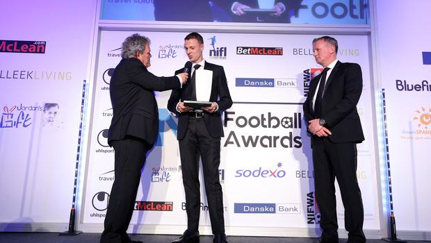 Press Eye - Belfast - Northern Ireland - 7th May 2018  -   NI Football Awards at the Crowne Plaza Hotel.  TRAVEL SOLUTIONS INTERNATIONAL PERSONALITY OF THE YEAR Michael OÕNeill makes a presentation to Jonny Evans, International Personality of the Year   Photo by Kelvin Boyes / Press Eye