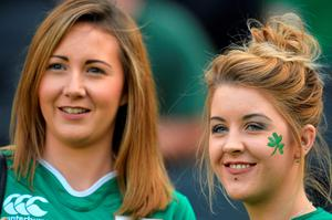 Irish fans pose before a Pool D match of the 2015 Rugby World Cup between Ireland and Italy at the Olympic Stadium, east London, on October 4, 2015. AFP PHOTO / GLYN KIRK RESTRICTED TO EDITORIAL USE, NO USE IN LIVE MATCH TRACKING SERVICES, TO BE USED AS NON-SEQUENTIAL STILLSGLYN KIRK/AFP/Getty Images
