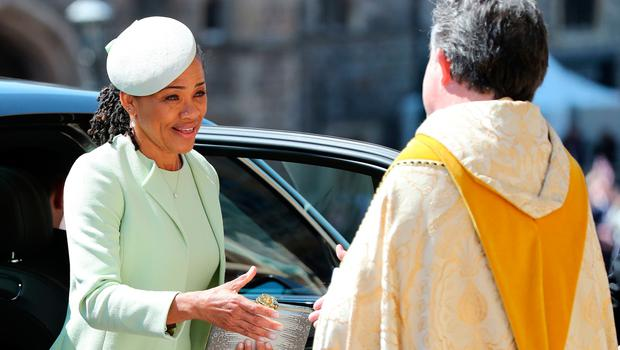 Meghan Markle's mother Doria Ragland (L) arrives for the wedding ceremony of Britain's Prince Harry, Duke of Sussex and US actress Meghan Markle at St George's Chapel, Windsor Castle, in Windsor, on May 19, 2018. / AFP PHOTO / POOL / Gareth FullerGARETH FULLER/AFP/Getty Images