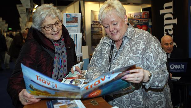 Mandatory Credit - Picture by Freddie Parkinson © Friday 18 January 2019 Belfast Telegraph Holiday World Show, Titanic Exhibition Centre, Belfast. Rosamund Harbinson from Coleraine with Gillian Galbraith of Belfast Telegraph