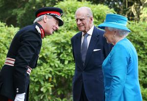 BELFAST, NORTHERN IRELAND - JUNE 23:  Queen Elizabeth II and Prince Philip, Duke of Edinburgh are met by David Lindsay, Lord Lieutenant of County Down (L) as they arrive at Hillsborough Castle on June 23, 2014 in Belfast, Northern Ireland. The Royal party are visiting Northern Ireland for three days.  (Photo by Peter Macdiarmid/Getty Images)