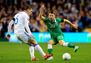 Wes Hoolahan (R) of Republic of Ireland and Ognjen Vranjes (L) Bosnia-Herzegovina during the Euro 2016 play-off second leg match at Aviva Stadium on November 16, 2015 in Dublin, Ireland.  (Photo by Charles McQuillan/Getty Images)