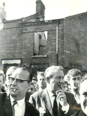 James Callaghan: Former British PM, deep in thought as he stands in front of one of a row of burnt out houses in Bombay street, Belfast. On the right is Gerry Fitt, MP. 27/8/1969