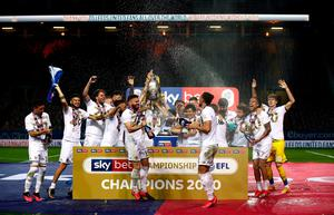 Stuart Dallas (front left) leads the Leeds celebrations after his side picked up the Championship trophy.