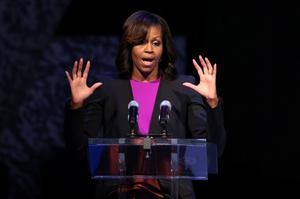US First Lady Michelle Obama addresses the crowd on stage at the visit by her and her two daughters Malia and Sasha to the Gaiety Theatre, Dublin for a special performance of Riverdance.  PRESS ASSOCIATION Photo. Picture date: Monday June 17, 2013. Photo credit should read: Julien Behal/PA Wire