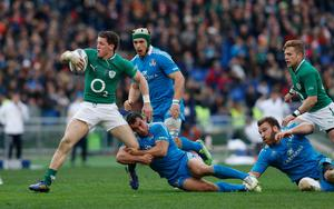 ROME, ITALY - MARCH 16:  Craig Gilroy of Ireland is tackled during the RBX Six Nations match between Italy and Ireland at Stadio Olimpico on March 16, 2013 in Rome, Italy.  (Photo by Tom Shaw/Getty Images)