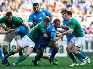 ROME, ITALY - MARCH 16:  Gonzalo Garcia of Italy (C) is tackled during the RBS Six Nations match between Italy and Ireland at Stadio Olimpico on March 16, 2013 in Rome, Italy.  (Photo by Paolo Bruno/Getty Images)