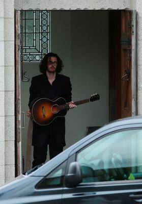 Singer Hozier at the church of Our Lady of Perpetual Succour in Foxrock, Dublin, where he was due to perform at the funeral service of Olivia Burke. PRESS ASSOCIATION Photo. Picture date: Wednesday June 24, 2015. She died when a balcony collapsed in the college town of Berkeley, California. See PA story FUNERAL Balcony. Photo credit should read: Brian Lawless/PA Wire