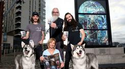 Follow the trail: Game of Thrones Direwolves Thor (Greywind) and Odin (Summer) pictured with owners William and Caelan Mulhall of Direwolf Tours and Flip Robinson of Giant Tours Ireland who was a stand-in for Hodor and The Mountain, helped launch the new visitor guide.