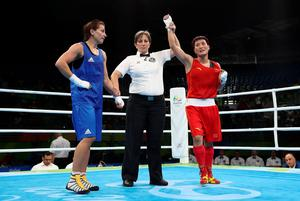 RIO DE JANEIRO, BRAZIL - AUGUST 15:  Junhua Yin of China defeats Yana Alekseevna of Azerbaijan in the womens Lightwieght 57-60kg during the Boxing at Riocentro on August 15, 2016 in Rio de Janeiro, Brazil.  (Photo by Julian Finney/Getty Images)