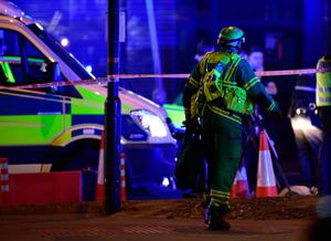 """A paramedic rushes to the scene as  police are dealing with a """"major incident"""" at London Bridge. Photo: Dominic Lipinski/PA Wire"""