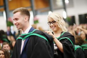 Graduating from Ulster University with a degree in Business Management are Peter Dunn (Newtownards) and Sheryl Hamilton from Castlederg. Pic By Paul Moane